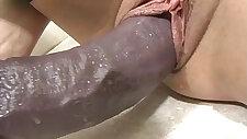 Busty amateur blonde in thigh highs loving a big brutal dildo