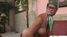 Hot granny is always in the mood for a hardcore interracial gangbang fuck