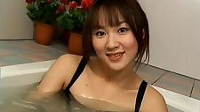Japanese Model fondles her twat and boobs